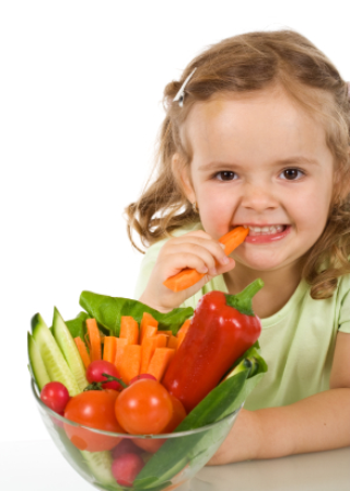 young girl eating veggies